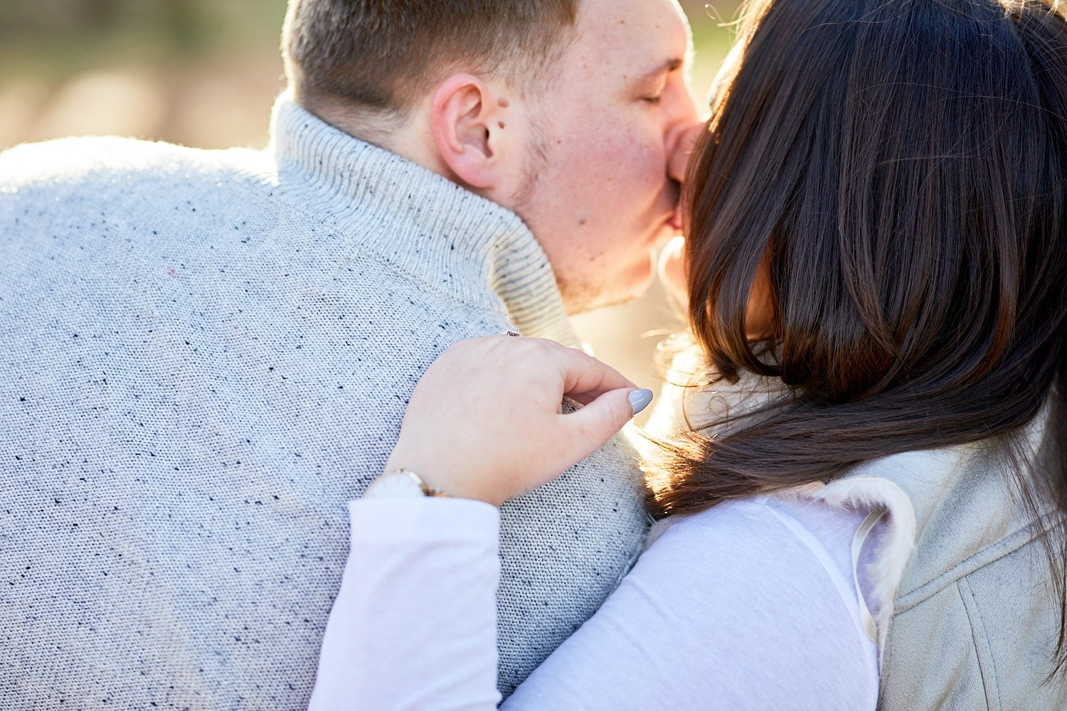 A couple kiss on a cool winter morning in Woodhall Spa, Lincolnshire
