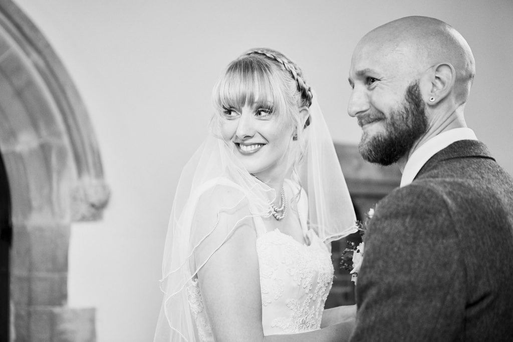A married couple look back at their guests in Gunby Hall, Lincolnshire on there wedding day