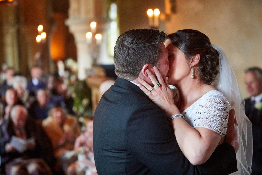 A couple kiss on their wedding at Howell Manor near Sleaford in Lincolnshire