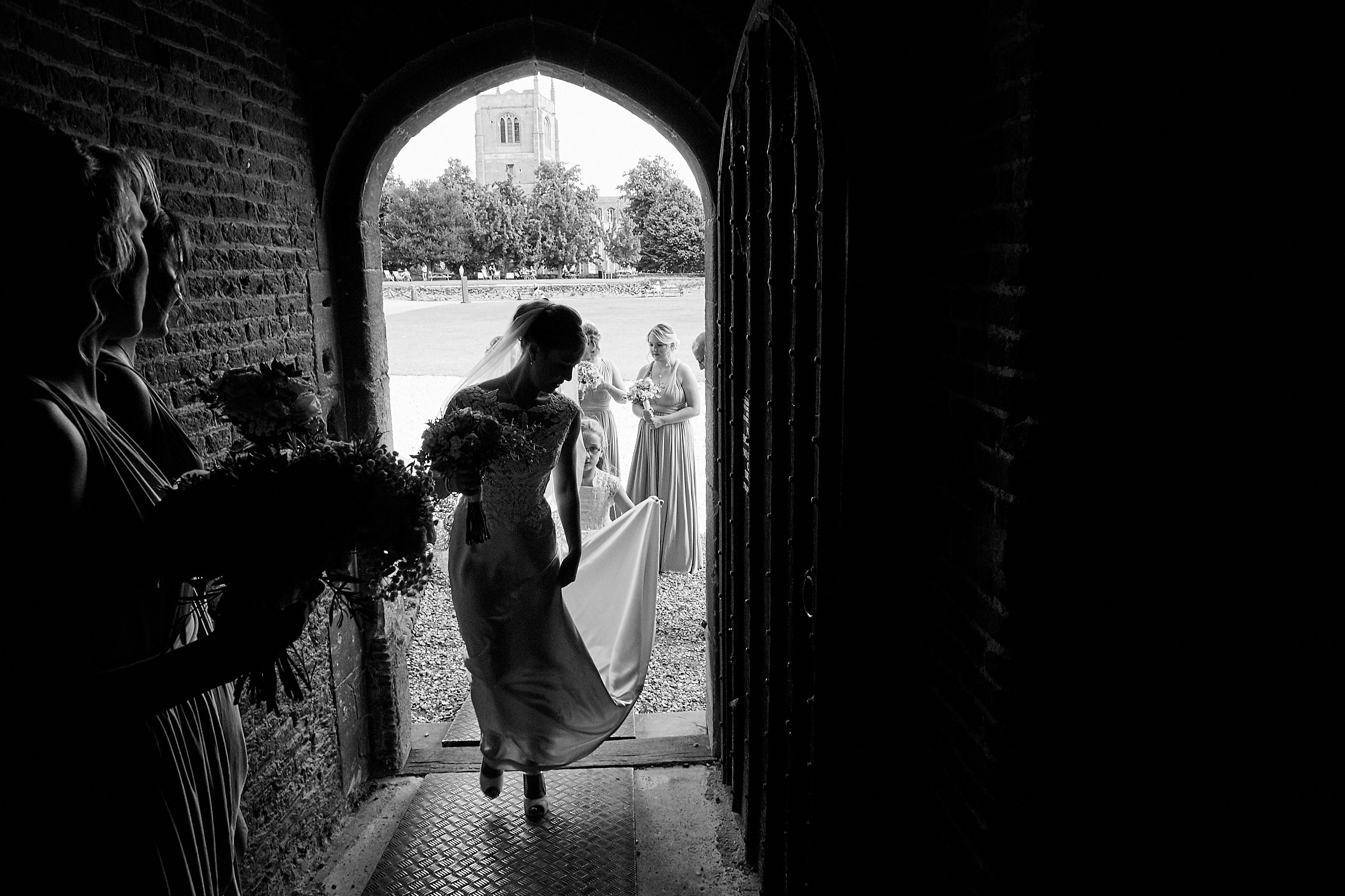 A bride enters Tattershall Castle