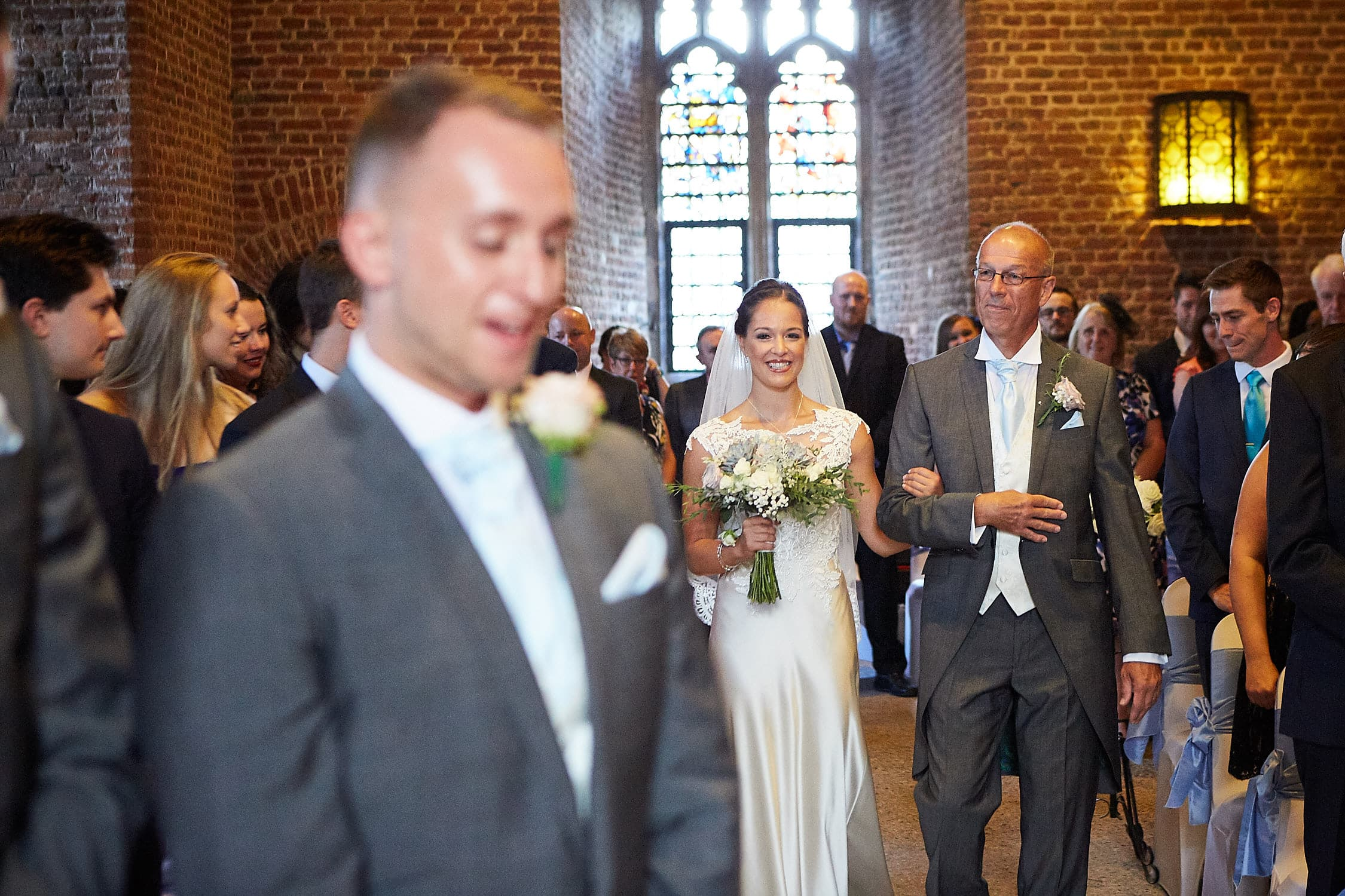 A father walks his daughter down the aisle at Tattershall Castle