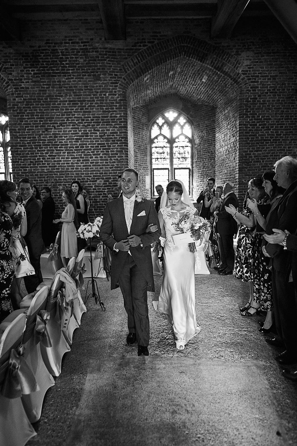Couple recessional Tattershall Castle, with the couple leaving the parlour room