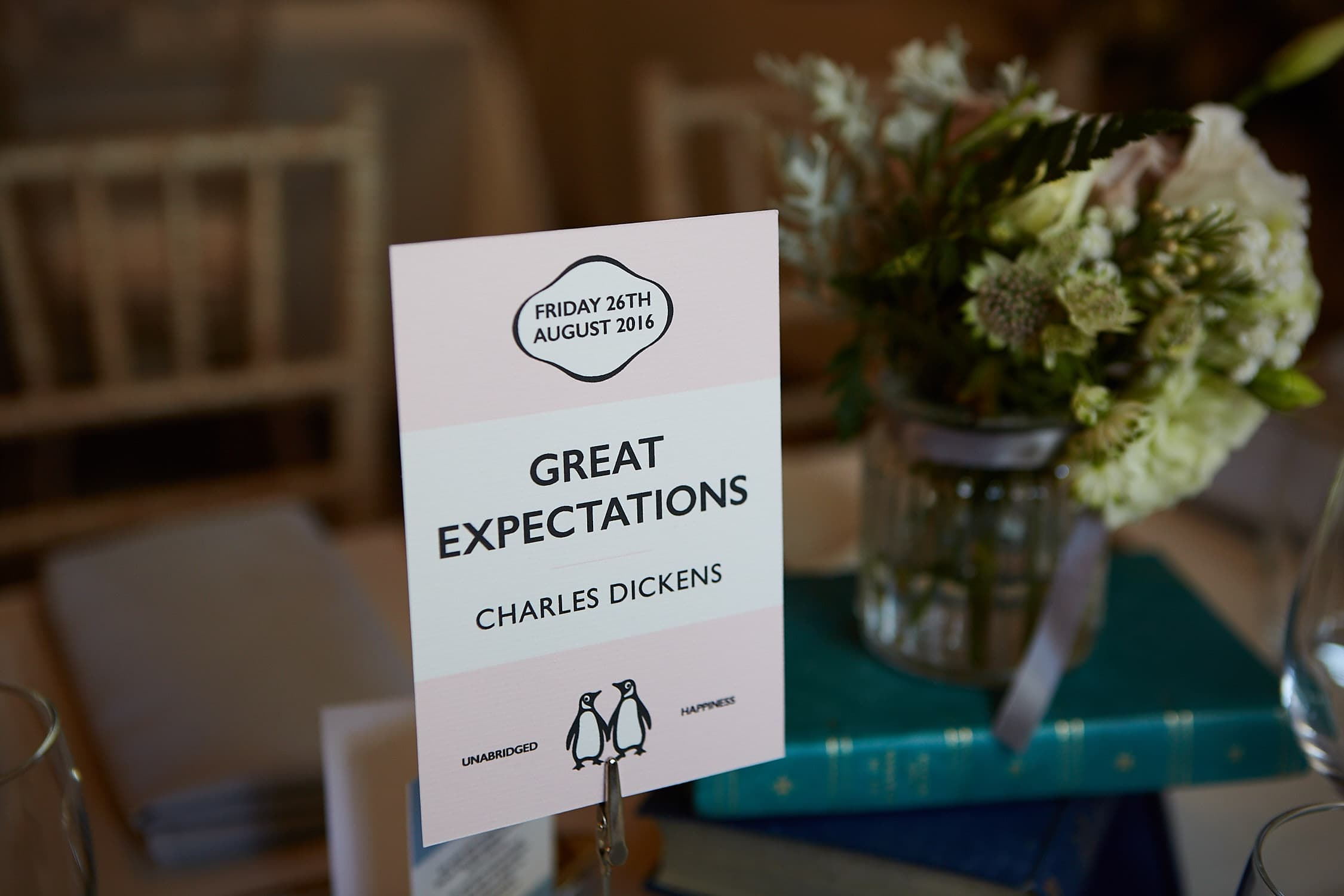 A table sign in a Penguin Books style