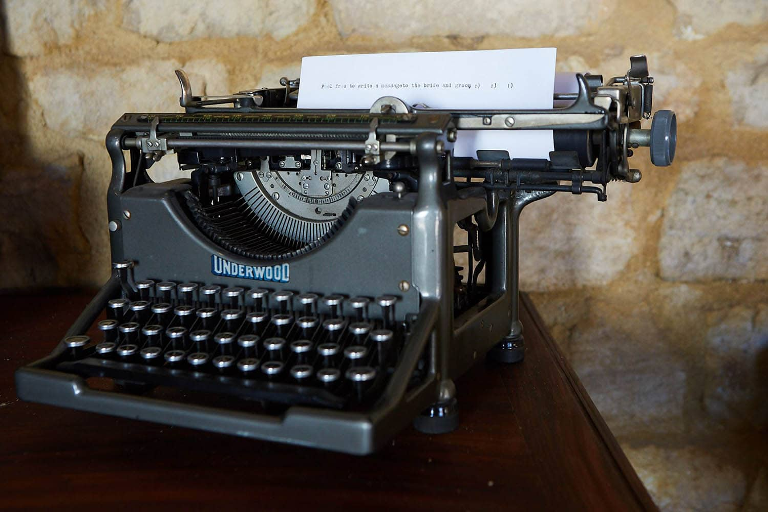 A vintage typewriter with a message for wedding guests to type messages of congratulations