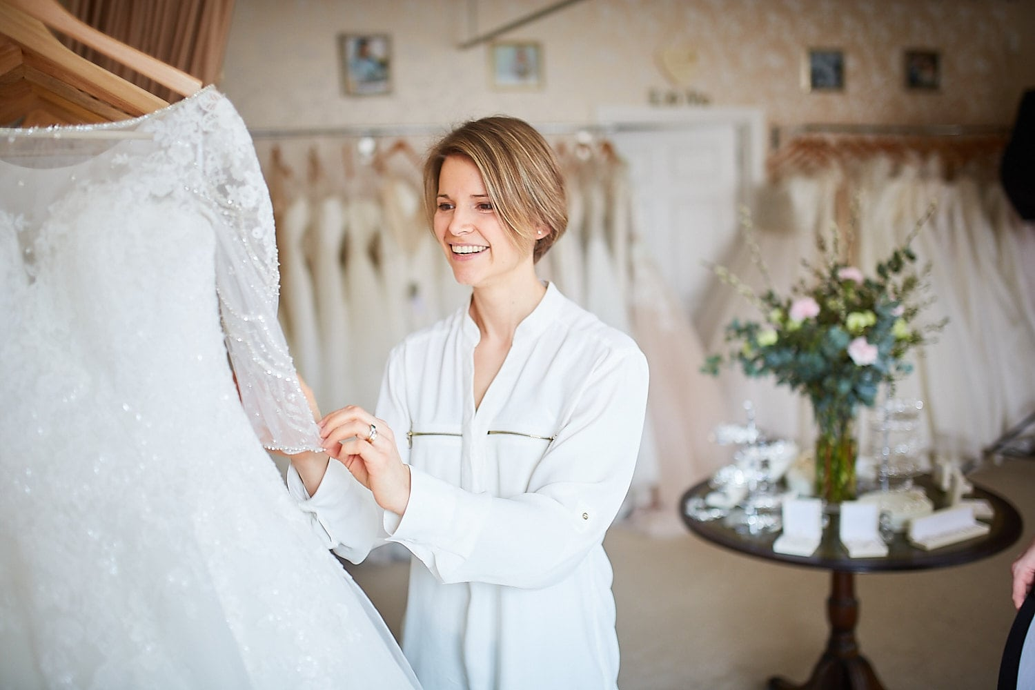Victoria, owner of The Ivory Room, Woodhall Spa looking at her dresses