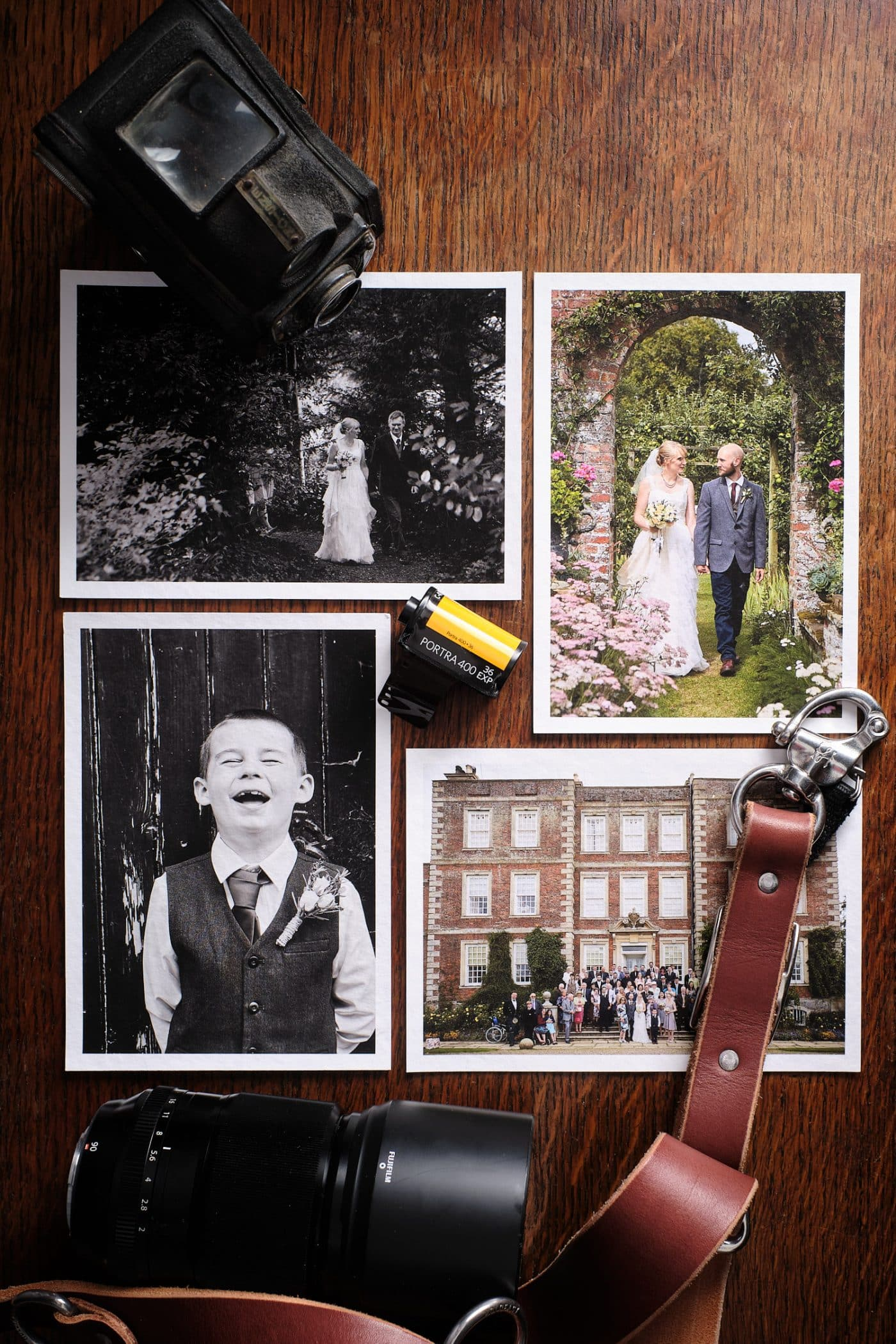 A flat lay image of giclèe prints with camera equipment