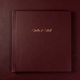 Dark red wedding album with gold text