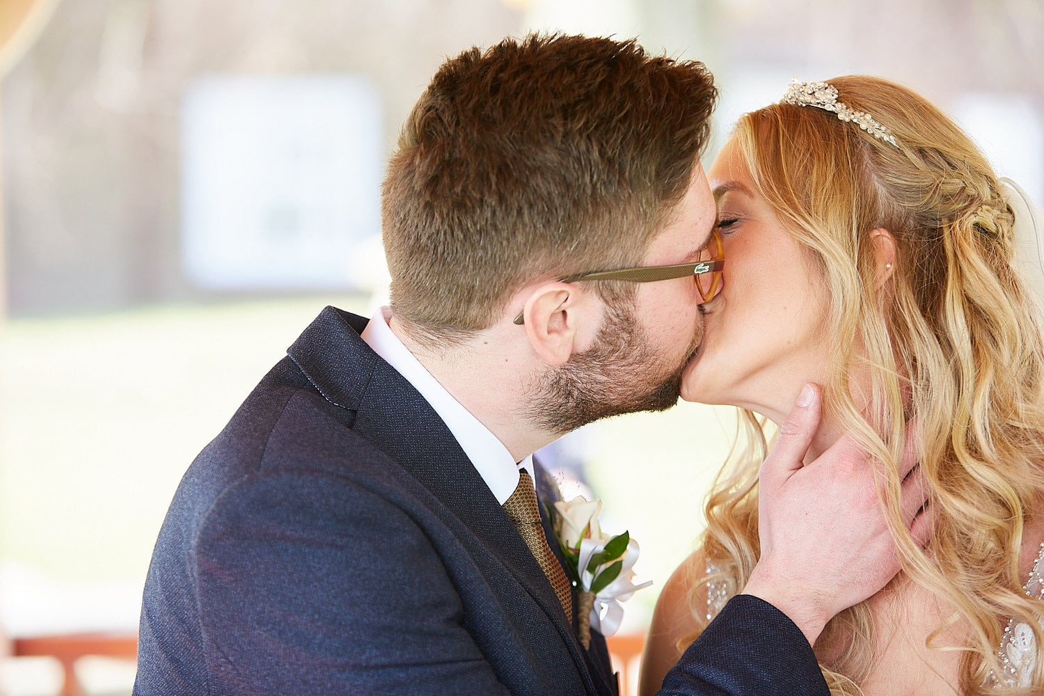 A bride and groom kiss to seal their marriage