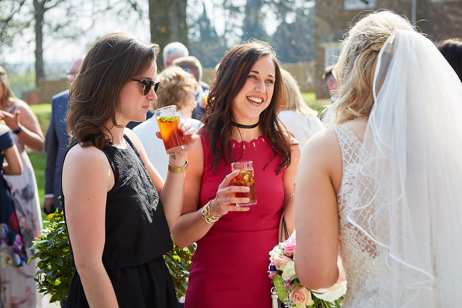 Friends look lovingly at the bride after she has just been married
