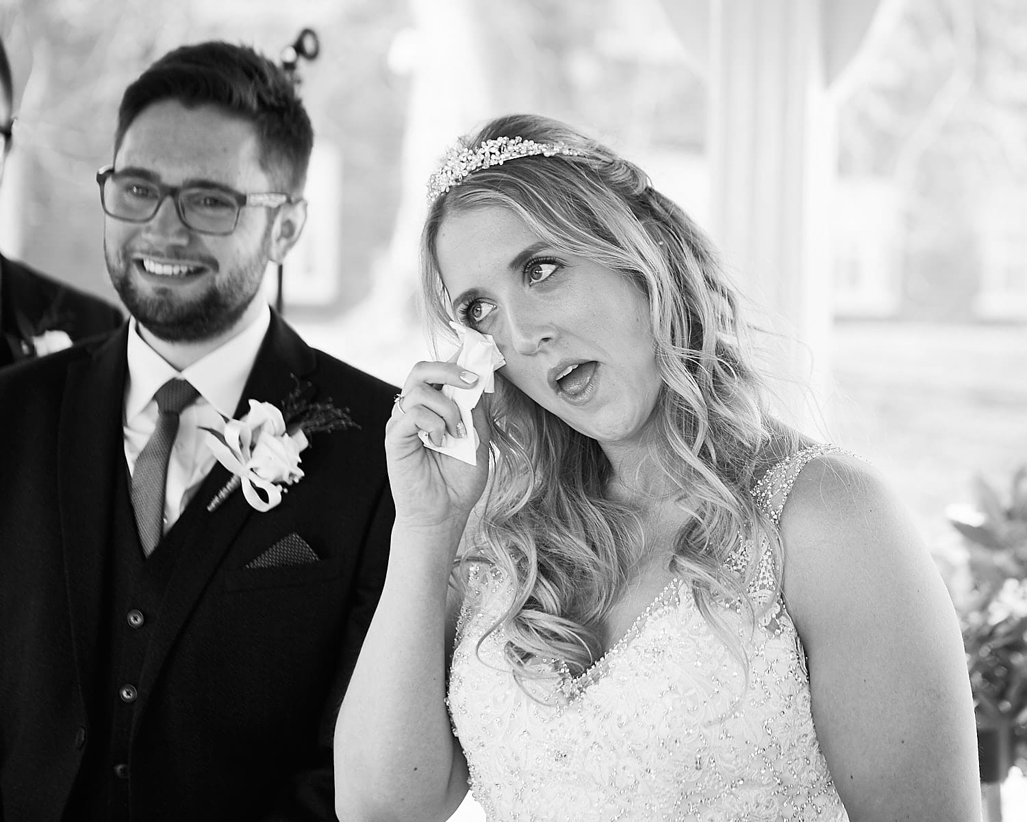 A bride wipes away a tear during her wedding ceremony at `Kenwick Park, Louth