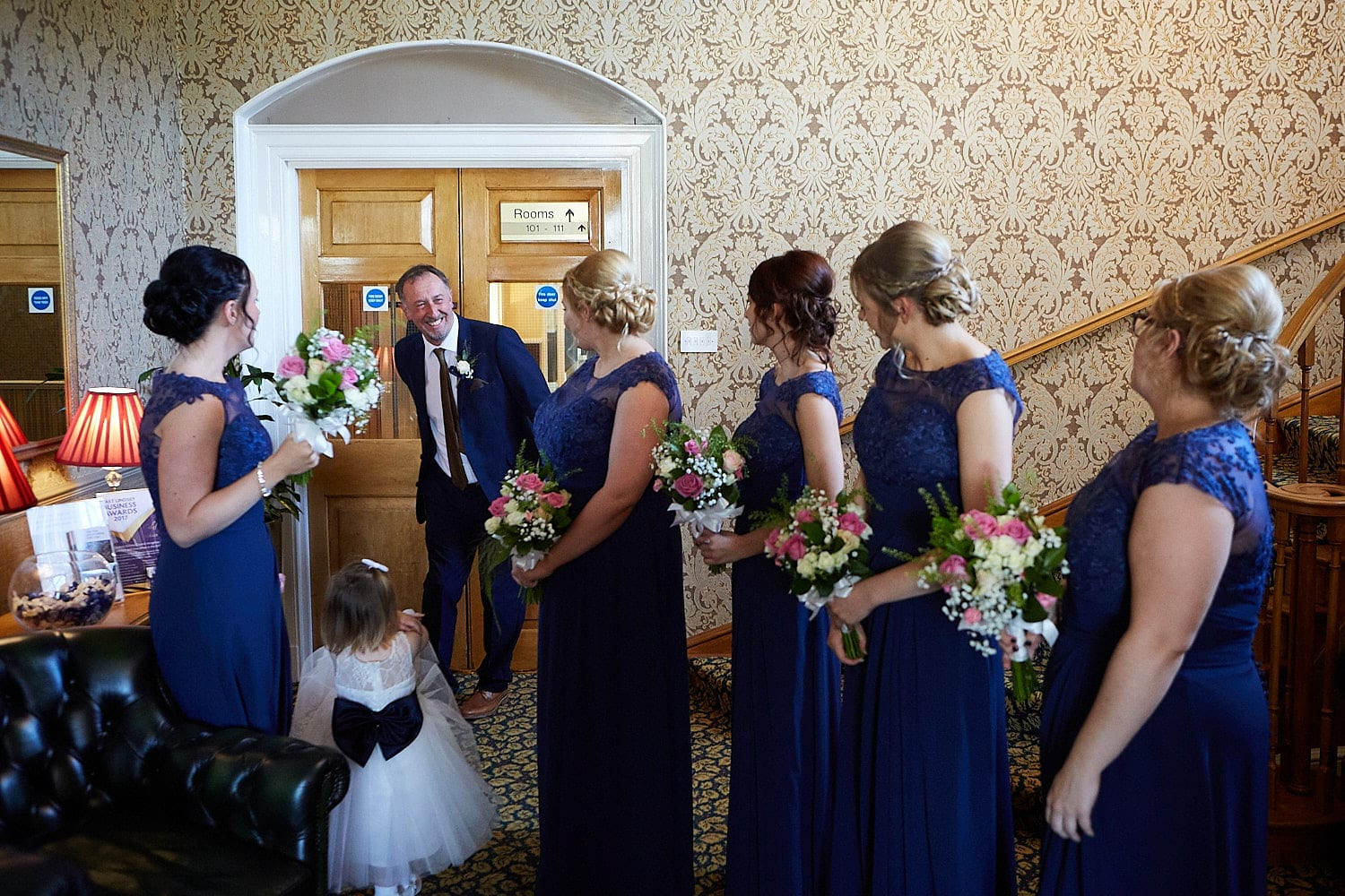 A father smiles with pride as she preps for her wedding