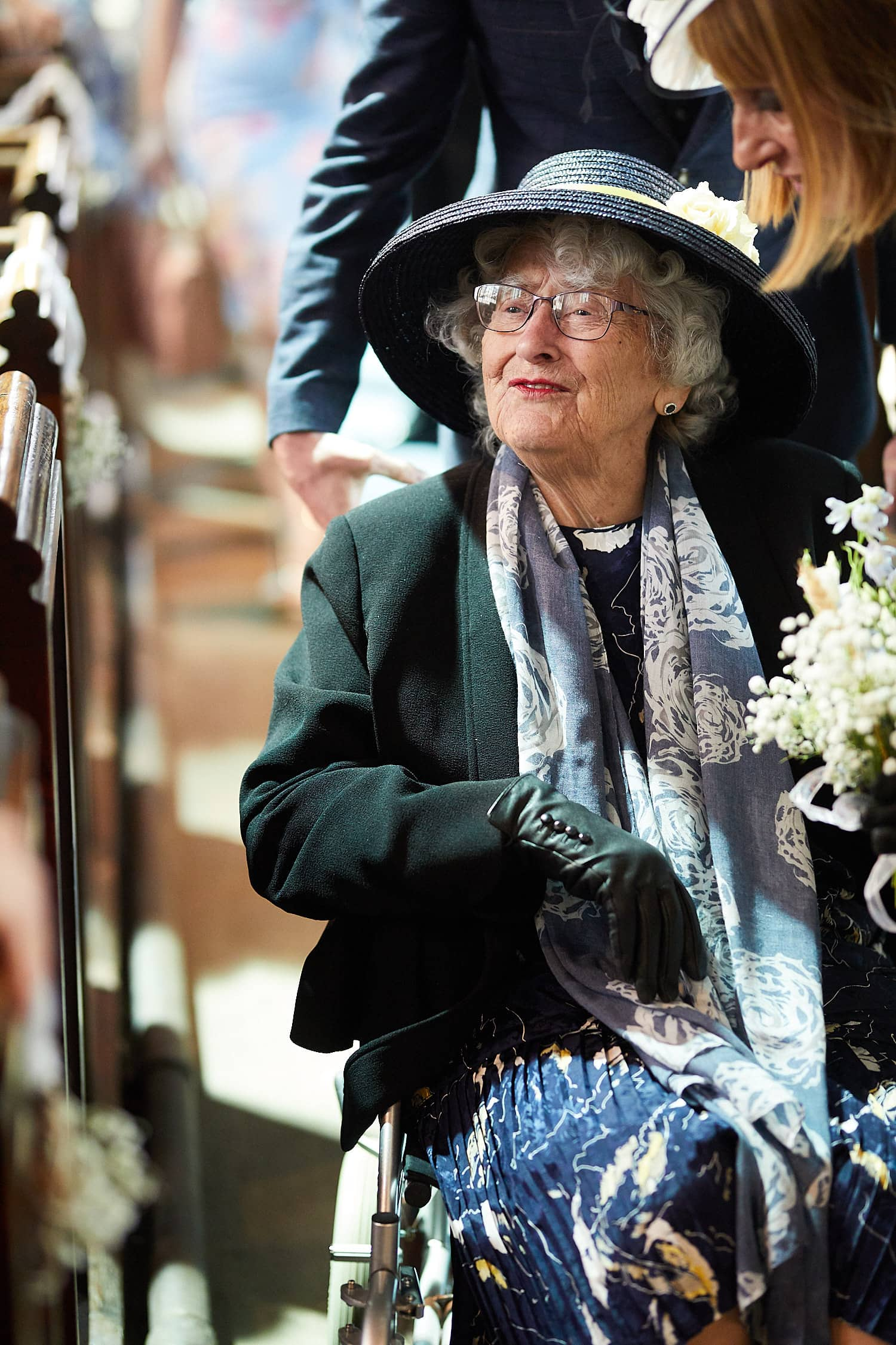 A grandmother arrives at church for the marriage of her grandson