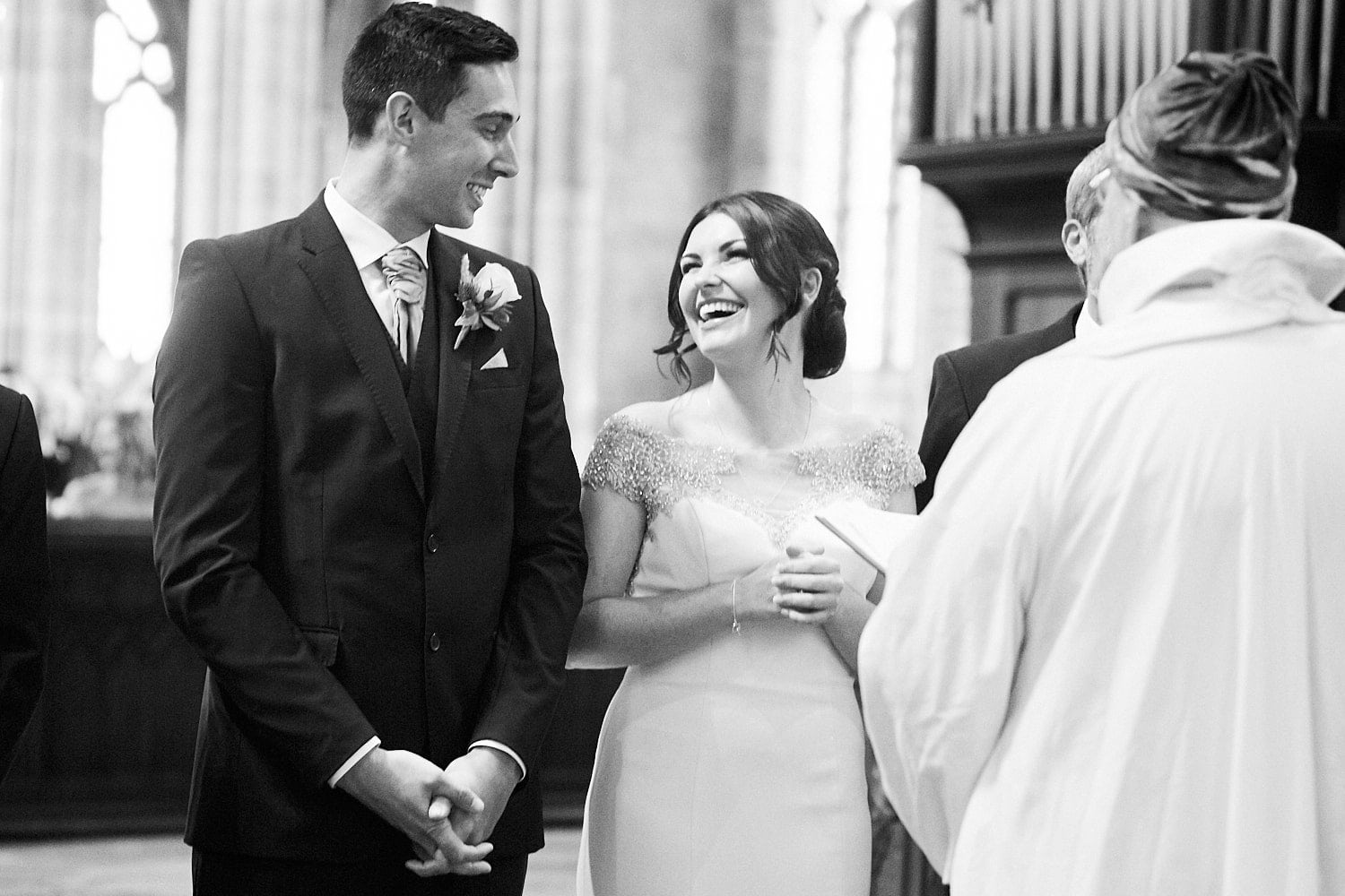 A bride and groom share a joke on their wedding day
