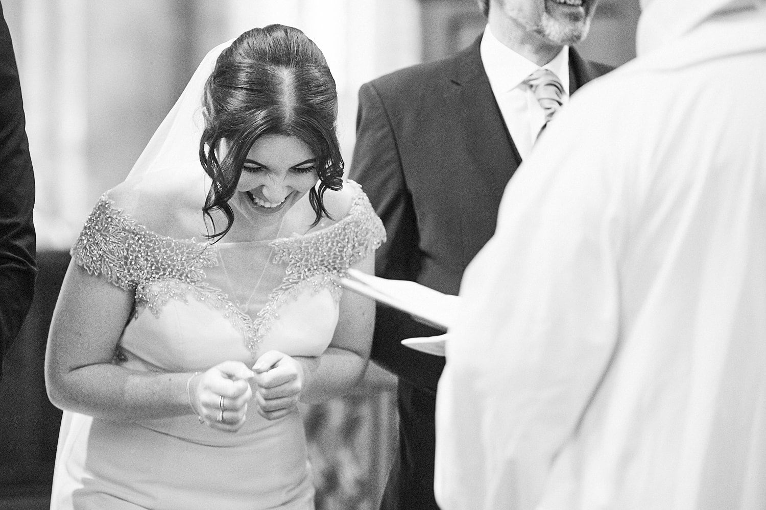 A bride gets the giggles in the church on her wedding day