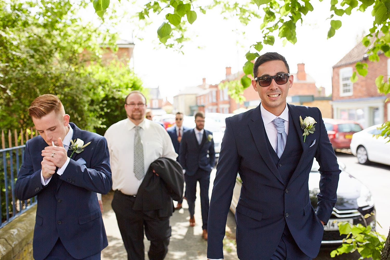 A groom and his best man walking to St Andrews Church in Heckington, Lincolnshire