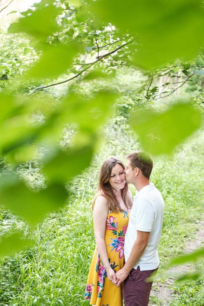 A couple kis sin woodland near Lincoln on their engagement shoot