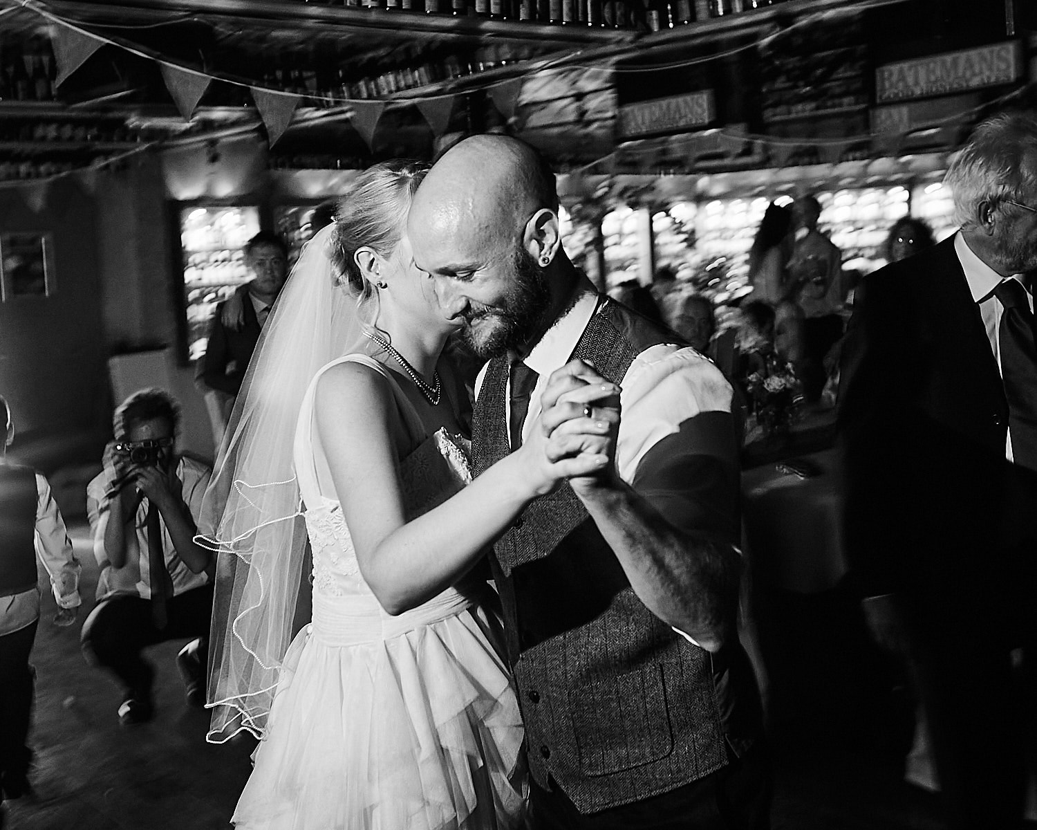 A couple share their first dance on their wedding day