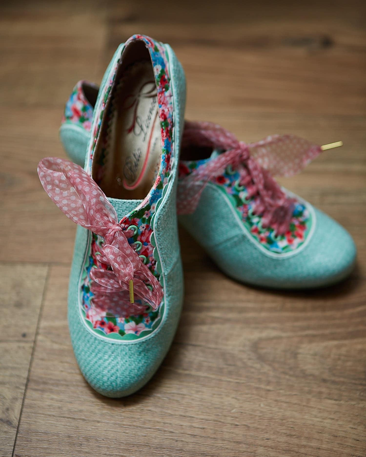 Irregular Choice wedding shoes on a wooden floor