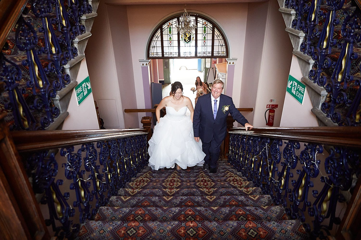 A bride and her father ascend the stairs for a Louth Town Hall wedding