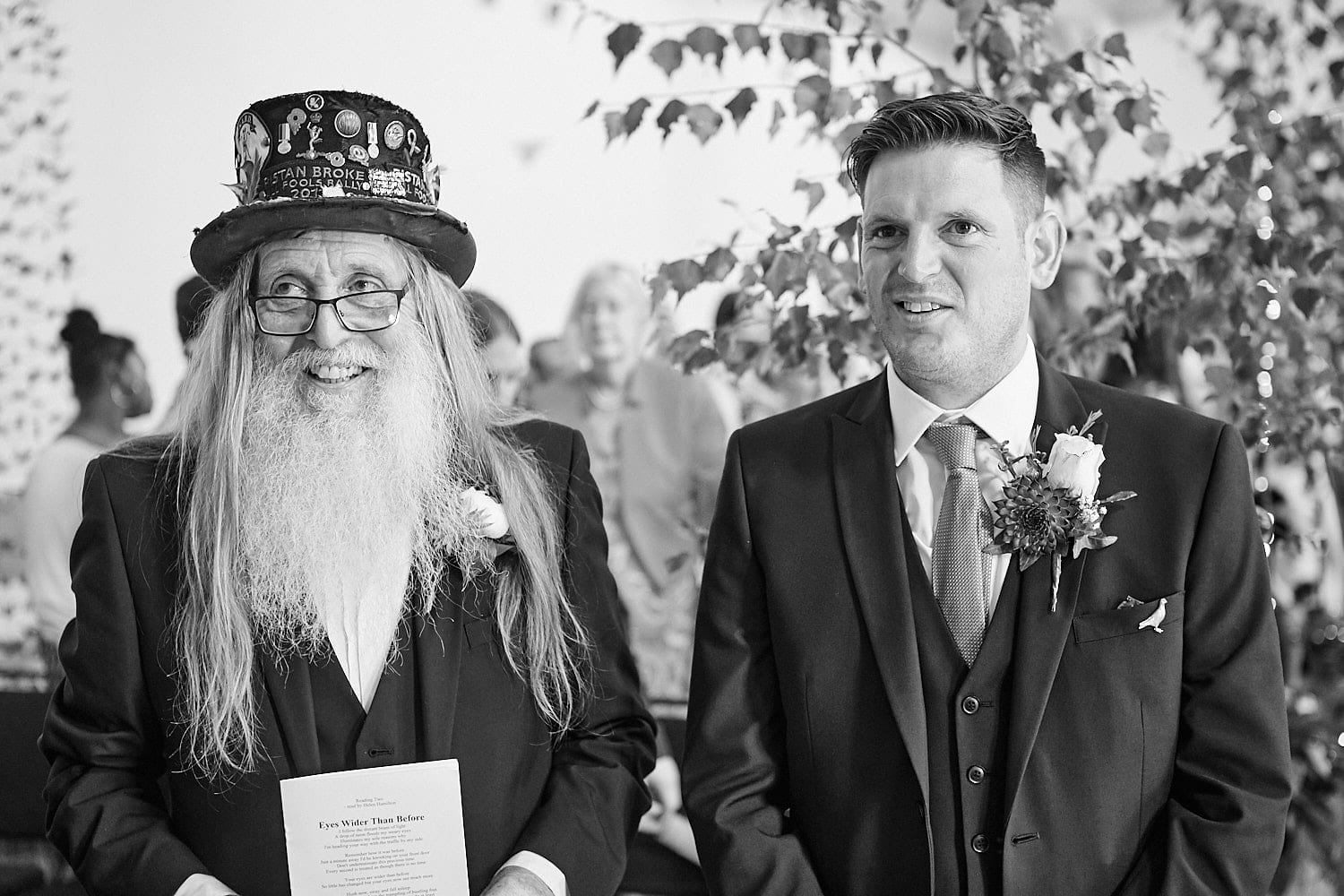 A groom and his father await the bride on his wedding day
