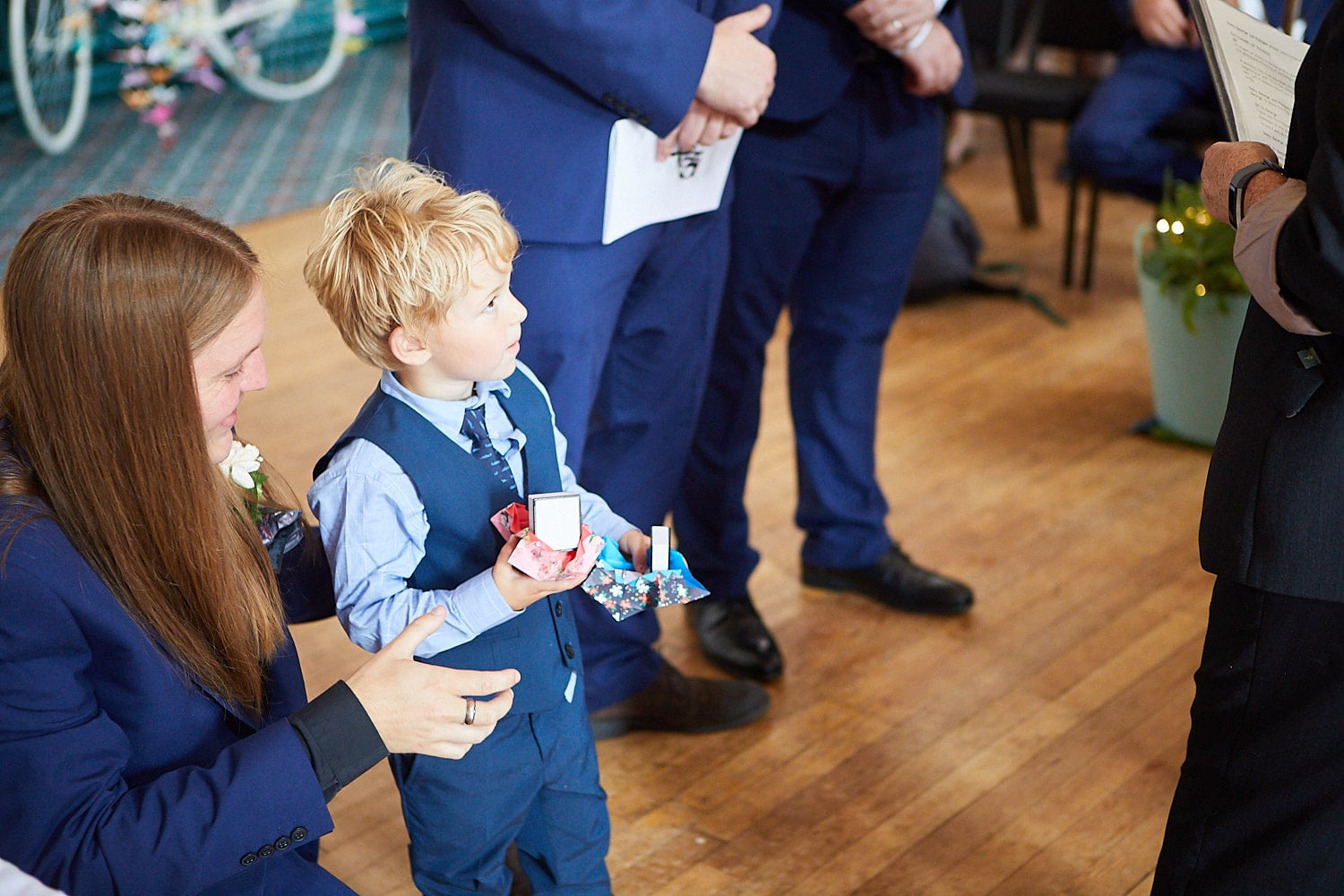 A small boy holds the rings on a wedding day
