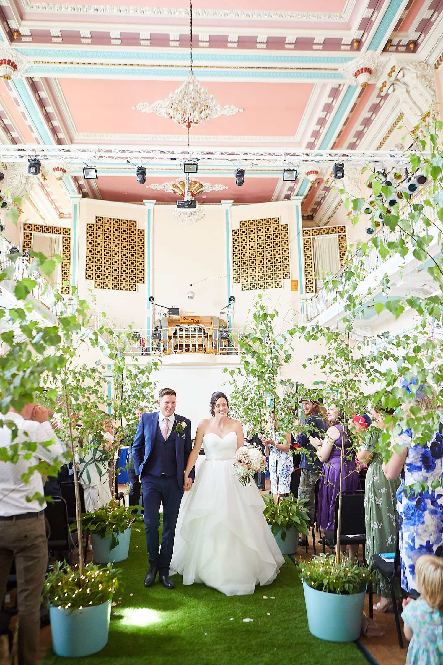 A Louth Town Hall wedding sees the bride and groom walk past family & friends