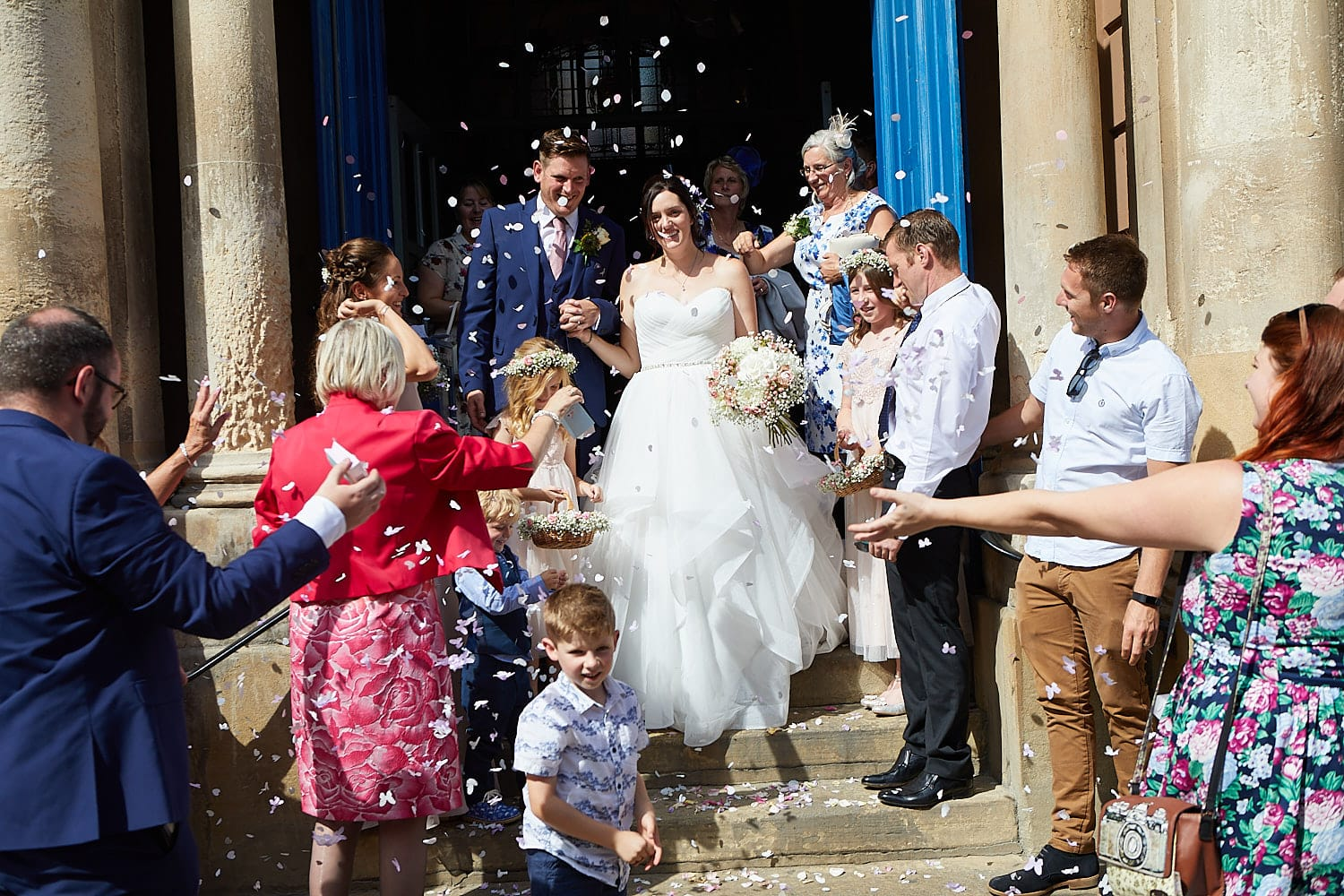 Friends and family throw confetti on the couple after their wedding at Louth Town Hall