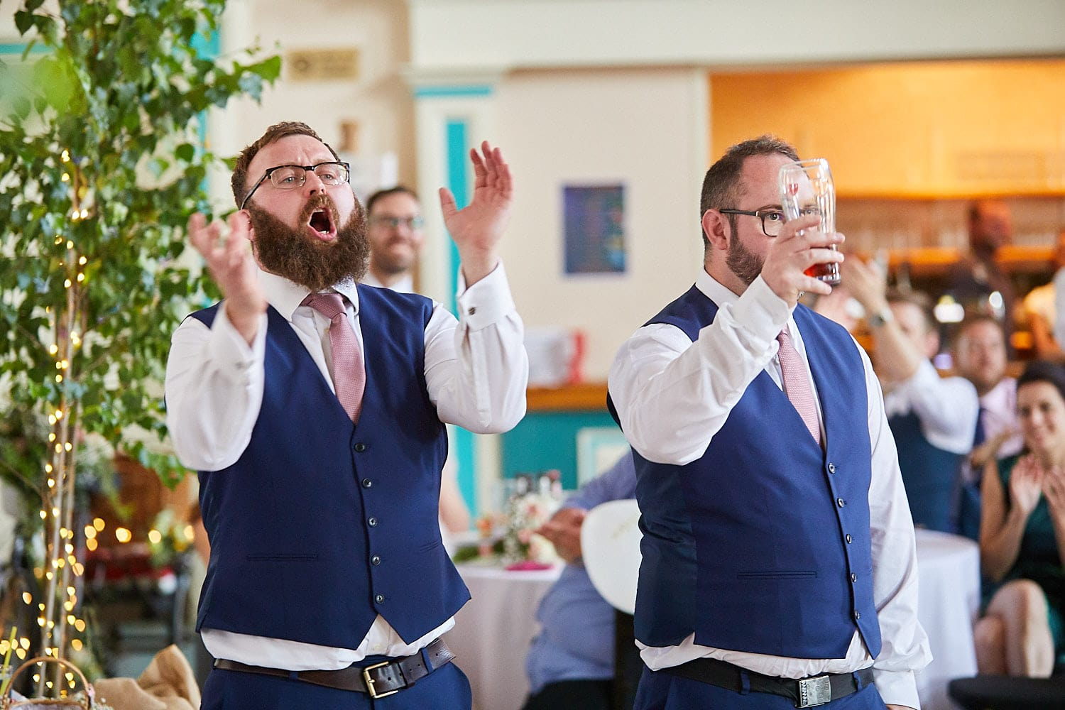 the best men cheer the speech of the groom on his wedding day
