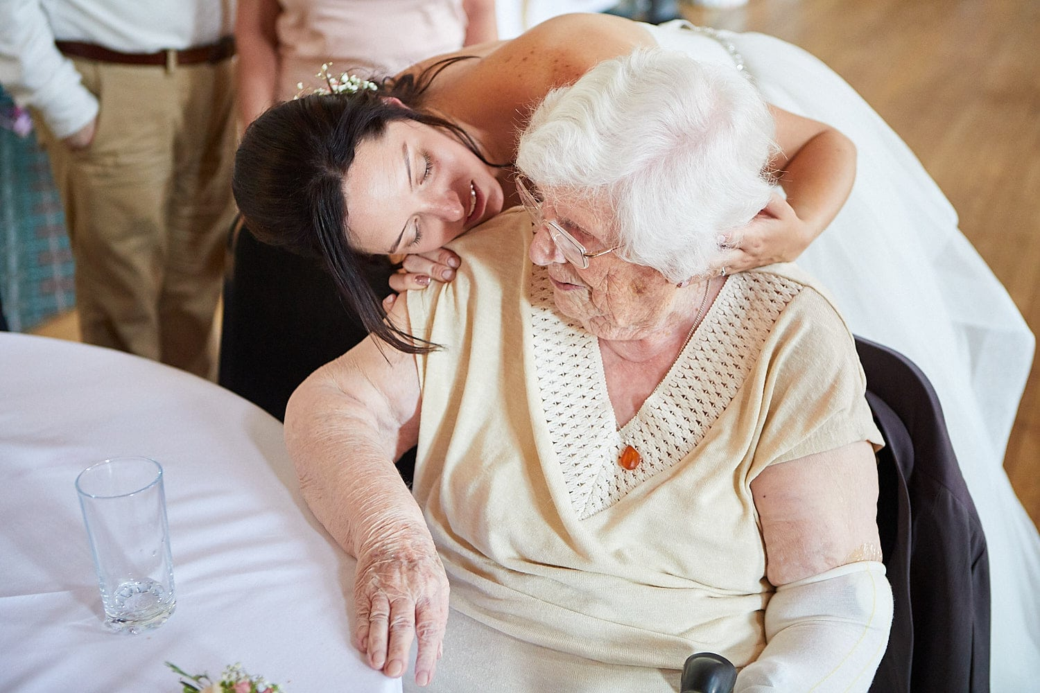 A bride shares a moment with her grandmother on her wedding day