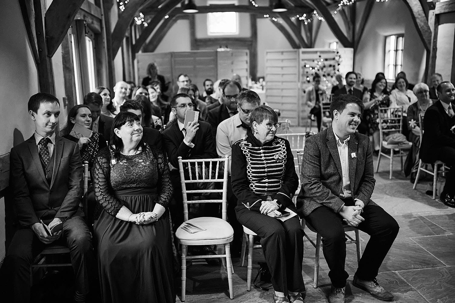 Friends and family look on proudly at the wedding of their friend