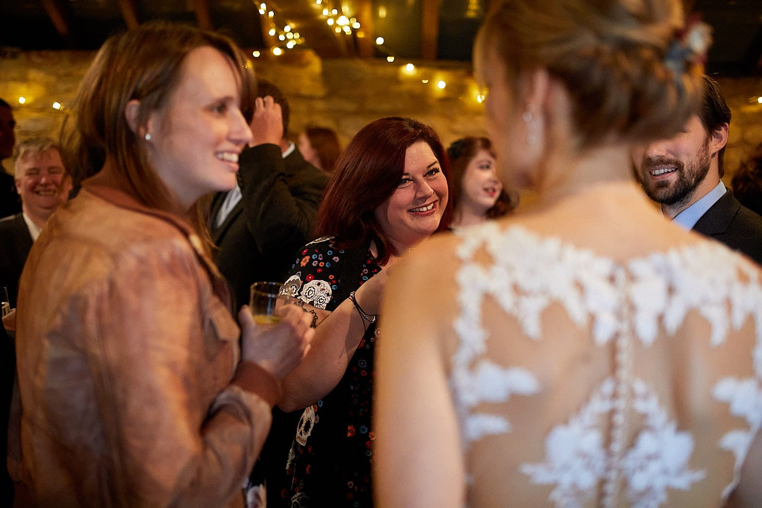 friends chat on a wedding day in Woodhall Spa