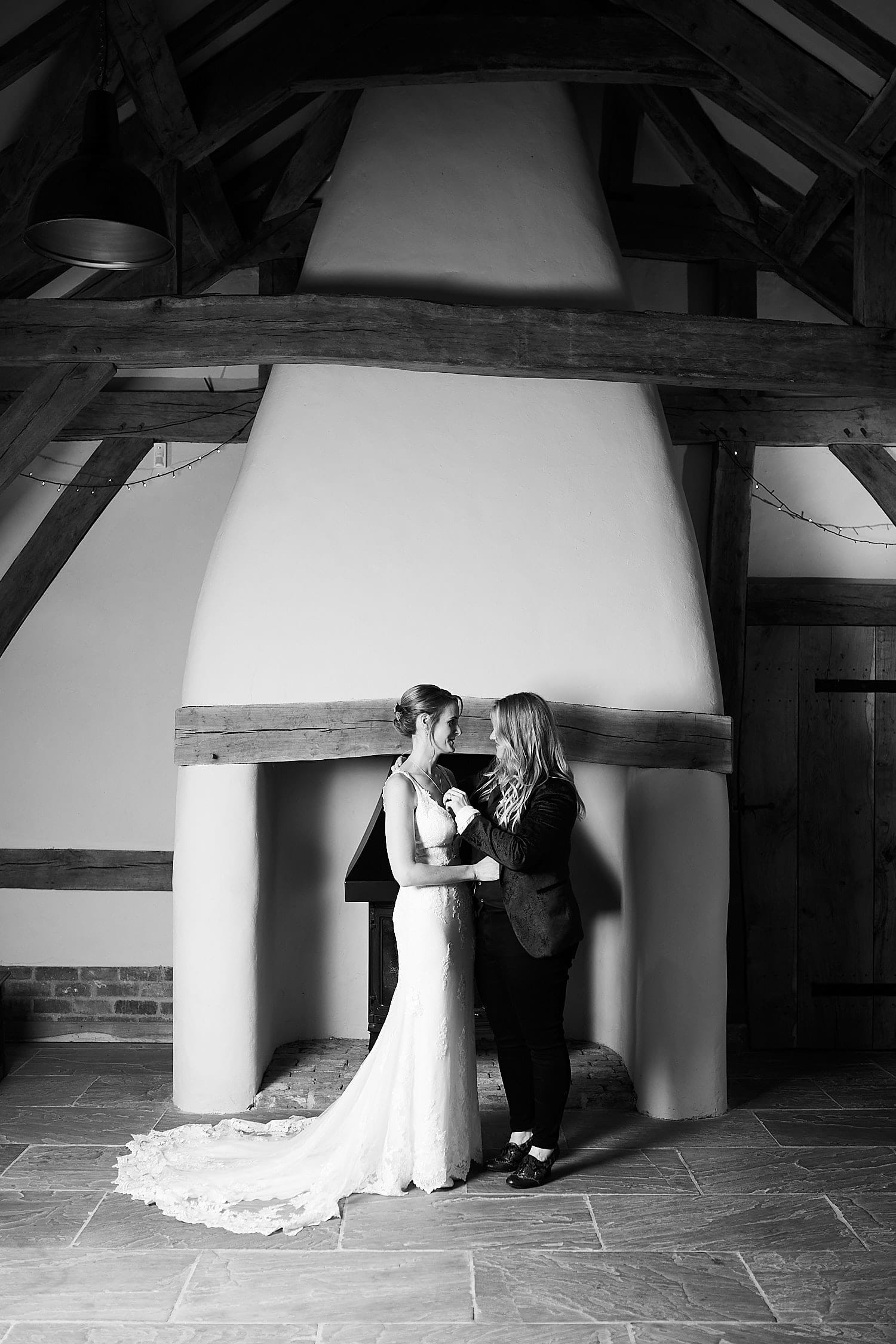 a lesbian couple pose spend a quiet moment together on their wedding day in Lincolnshire
