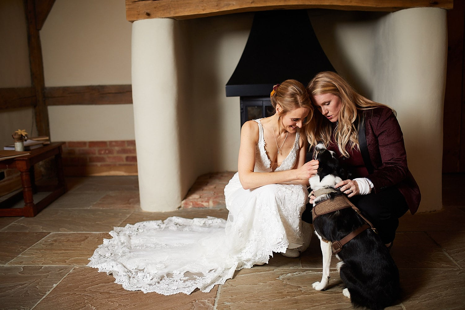 A couple pet their dog who was the ring bearer at their wedding