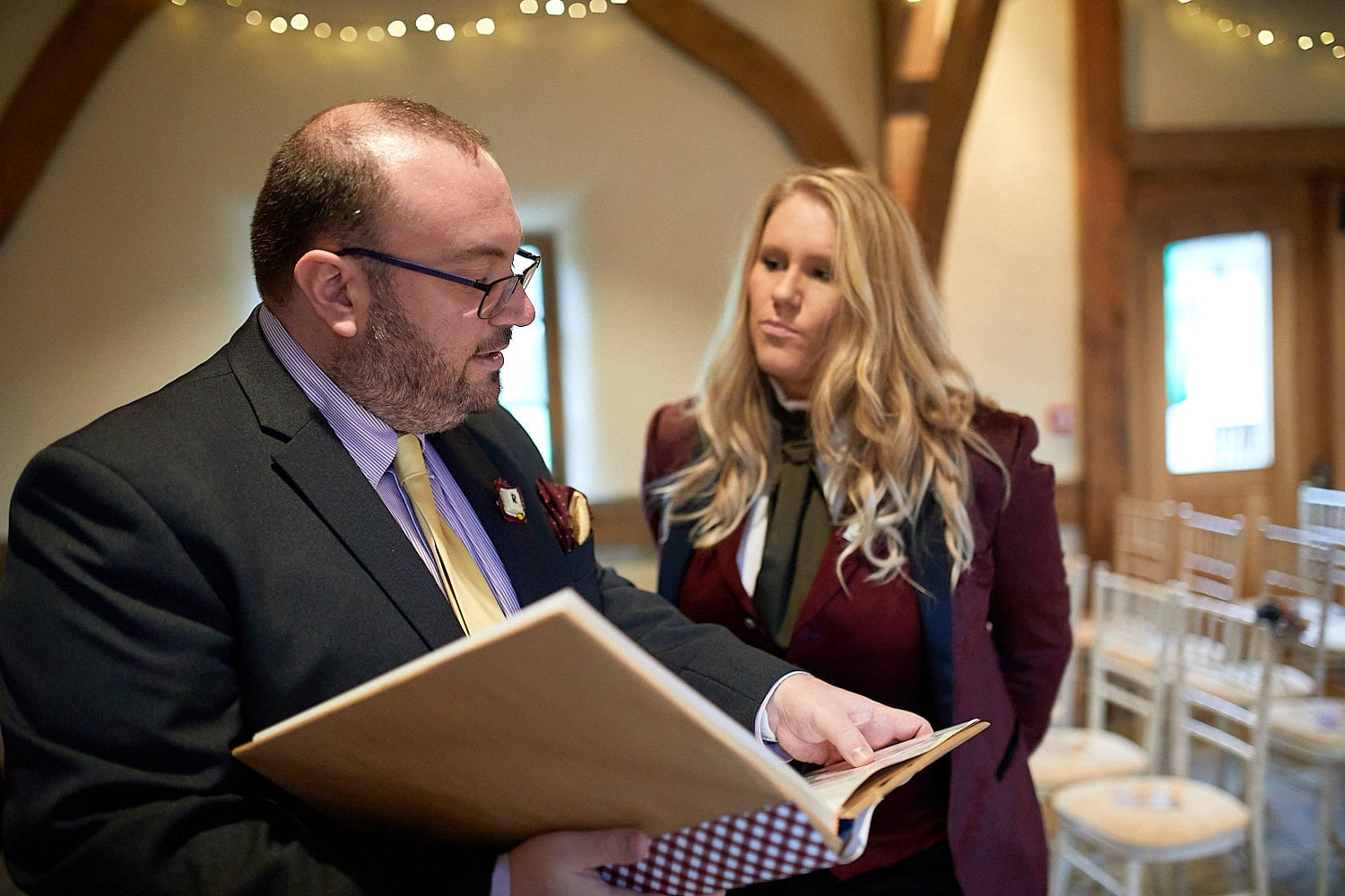 A bride and the celebrant discuss the ceremony at a same sex Lincolnshire Wedding