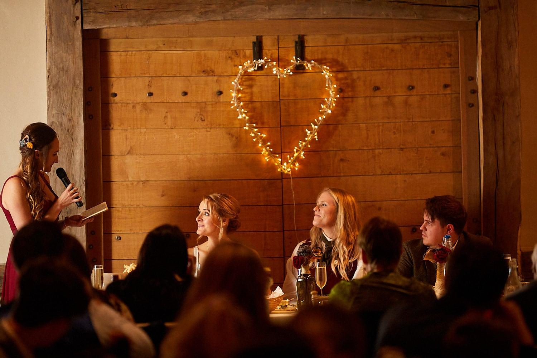 A bridesmaid gives a speech