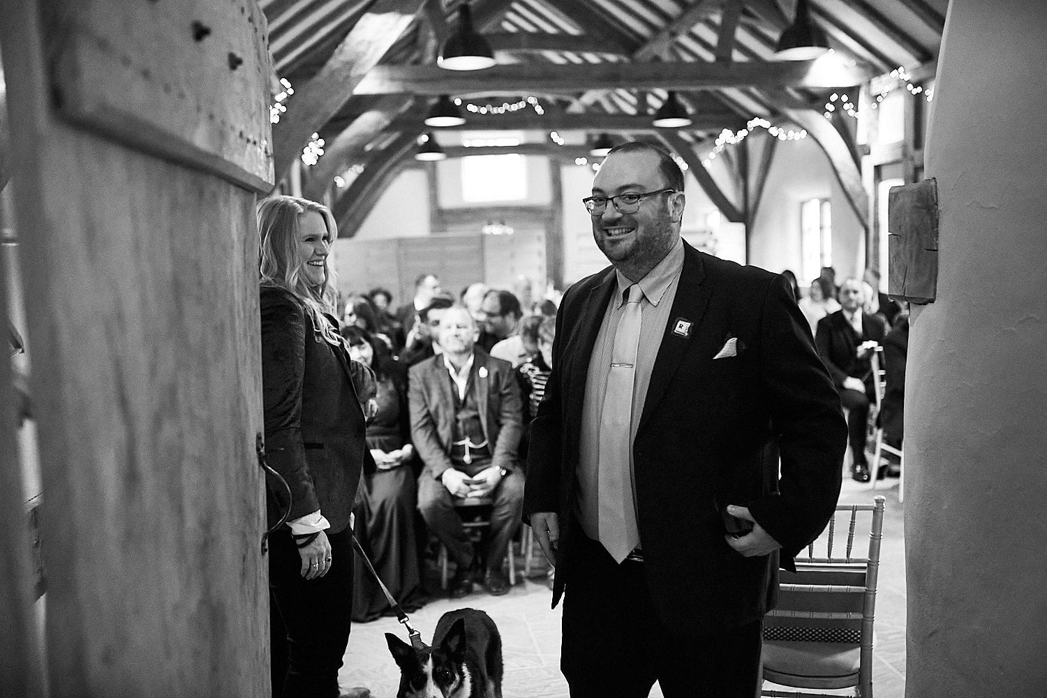 The celebrant gives a cheeky smile whilst waiting for the bride to arrive at a gay wedding in Lincolnshire