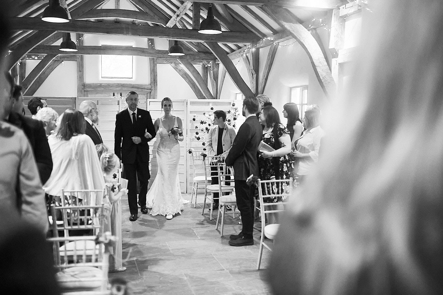 A father walks his daughter down the aisle at Abbey Farm, Woodhall Spa