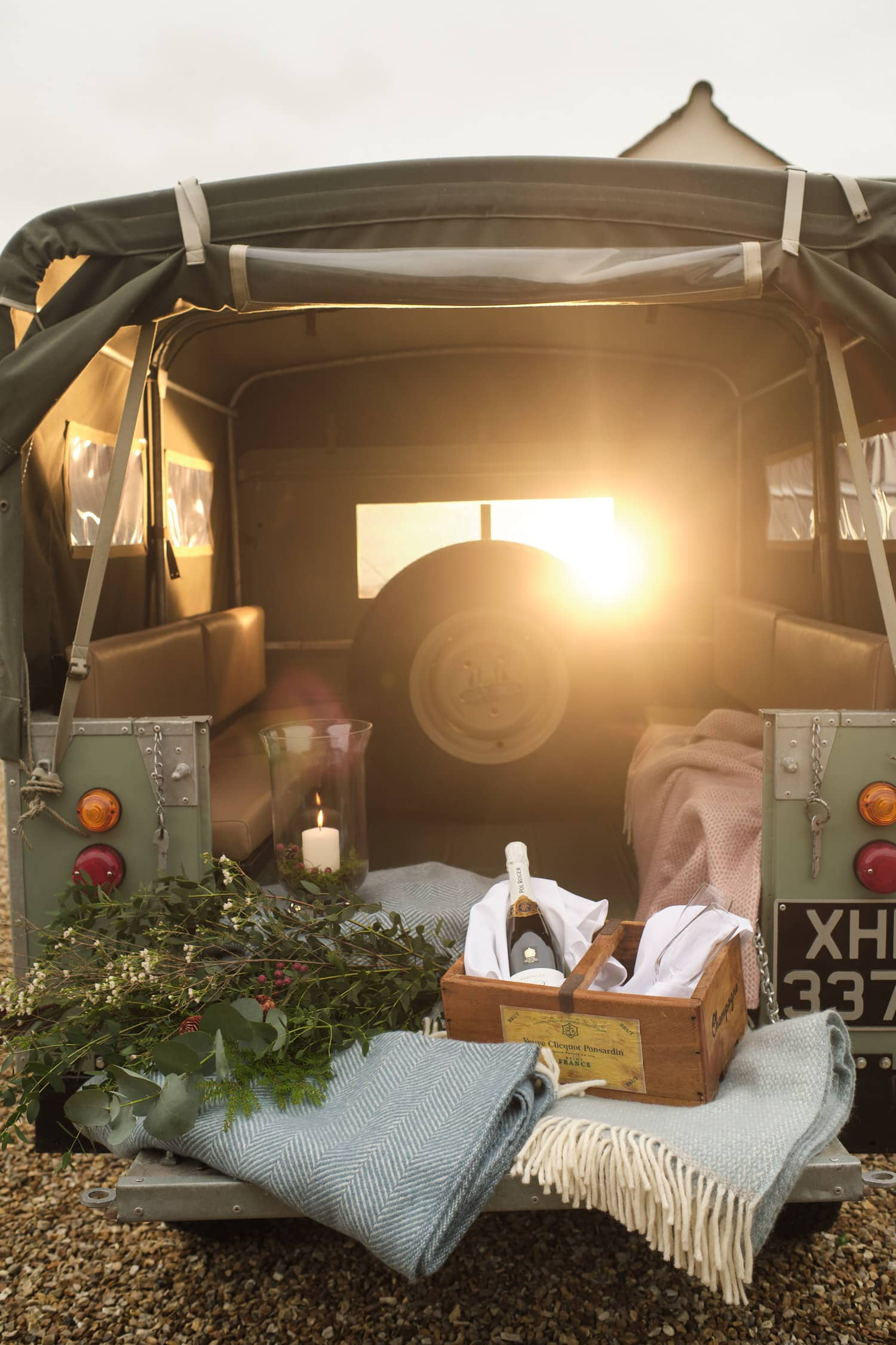 A Landrover with a romantic picnic in the backprepped for a wedding, an ideal way to travel to your minimony