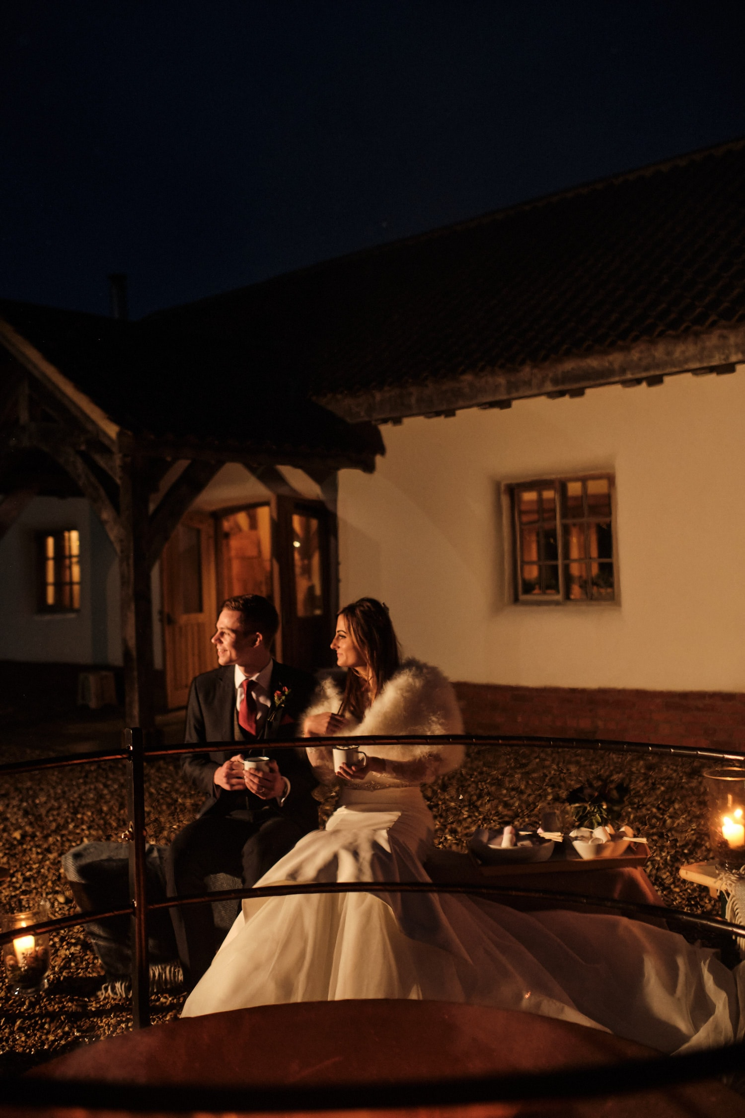 A couple sit outdoors at Abbey Farm Weddings. A venue with outdoor license for minimony