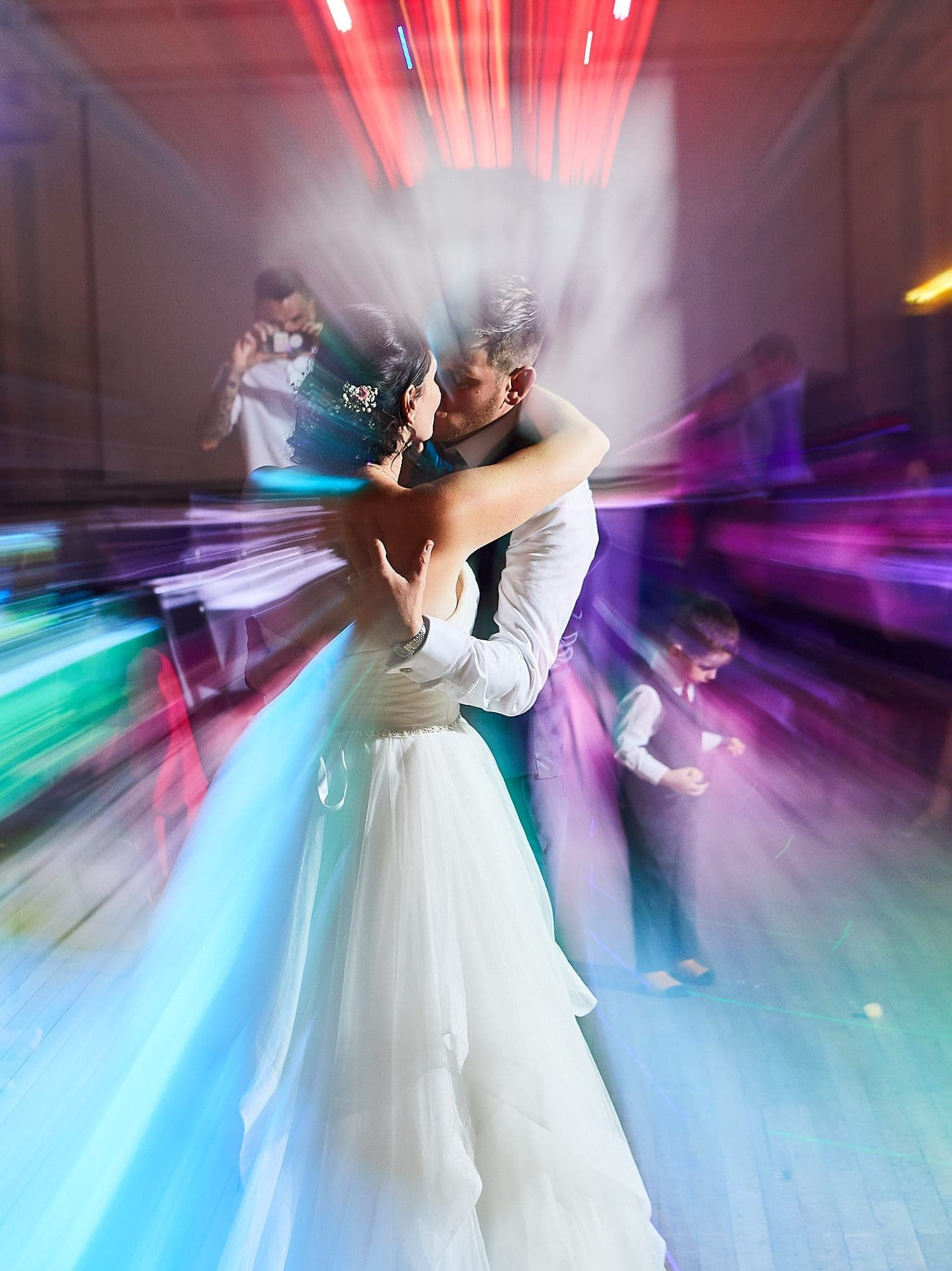A couple kiss on the dance floor on their wedding day in Louth
