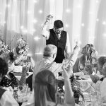 A groom toasts the guests on his wedding day during speeches in Louth