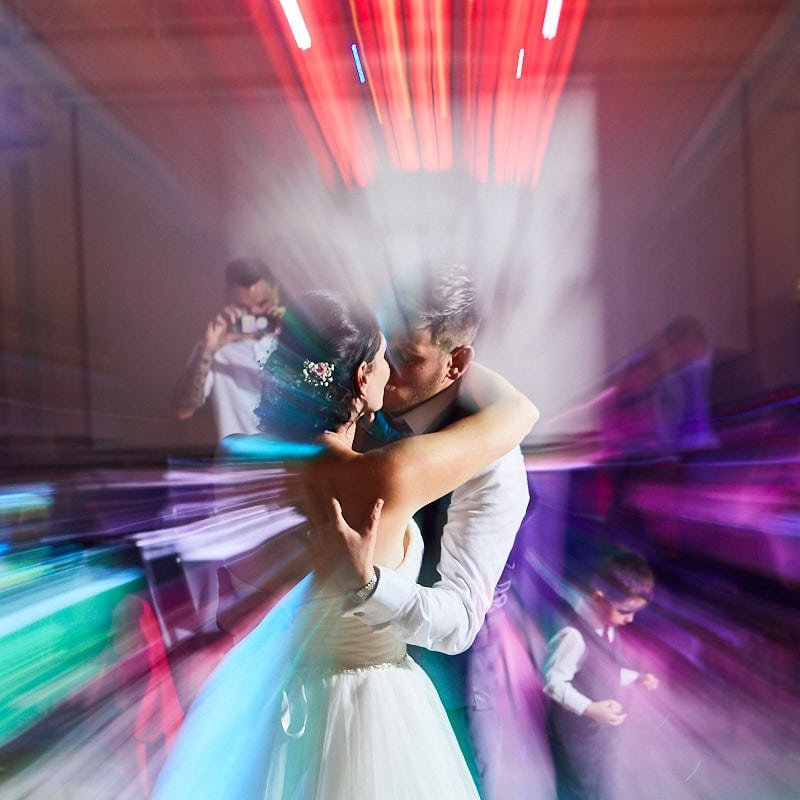Arty Alternative couple kiss at their wedding in Lincolnshire during first dance photographed by Lincolnshire Wedding photographers