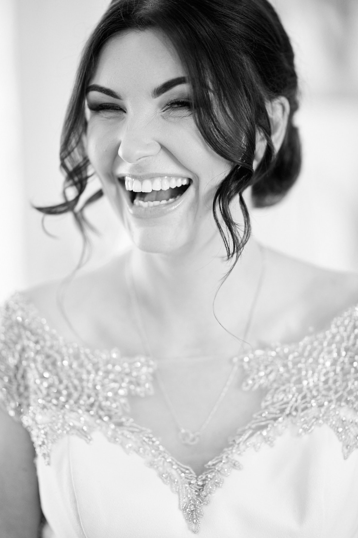A bride giggles on the morning of her wedding in Sleaford