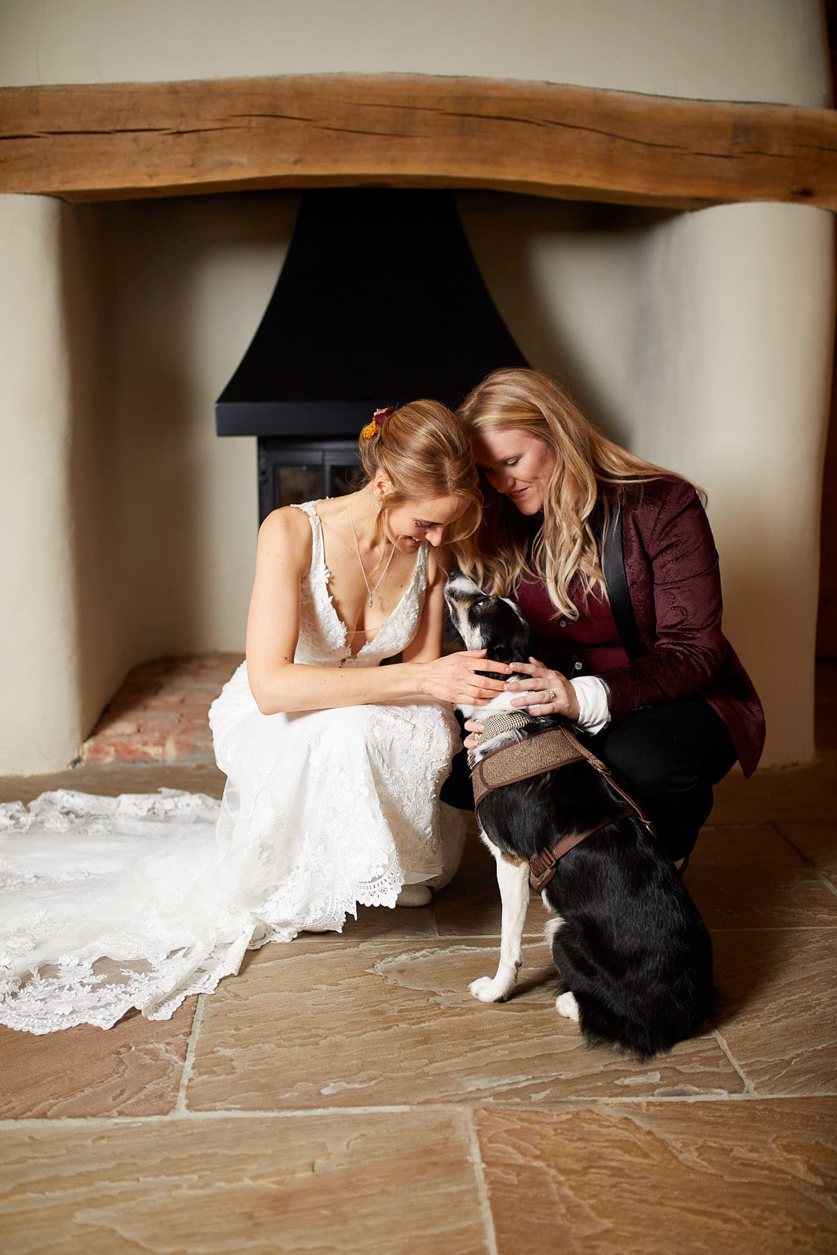 A couple celebrate their wedding day with their dog during a portrait session
