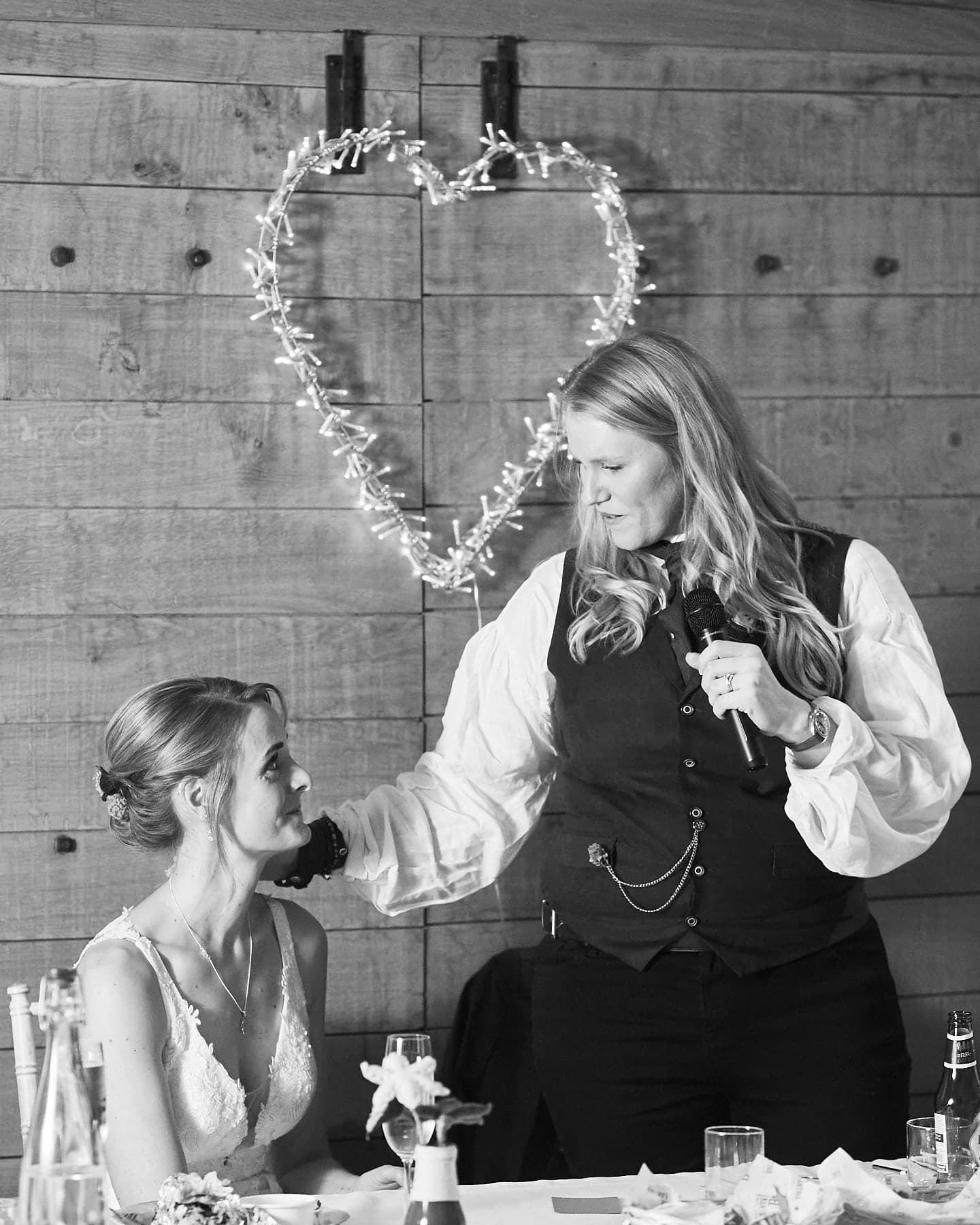 A tender moment as the bride talks about her partner during a Woodhall Spa wedding.