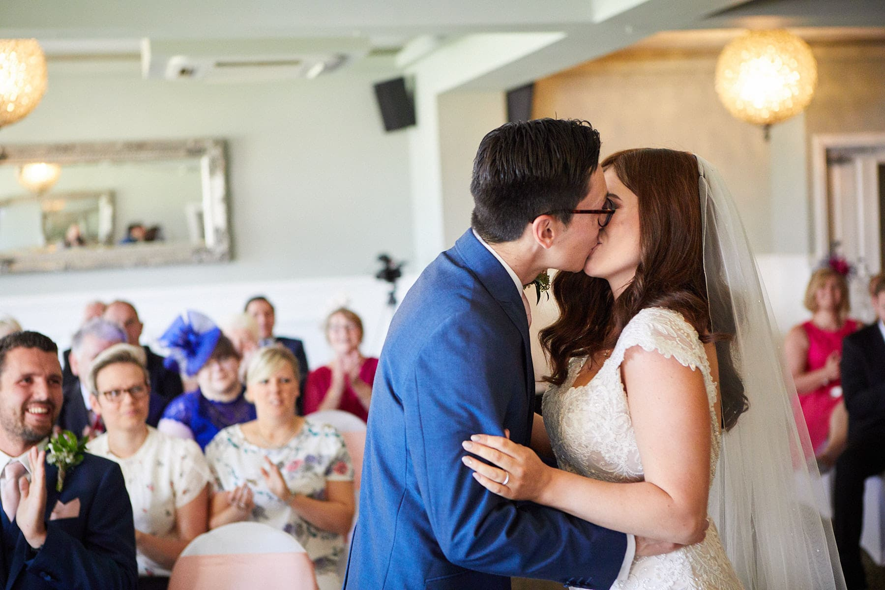 A couple kiss during her wedding at The Vine Hotel in Skegness
