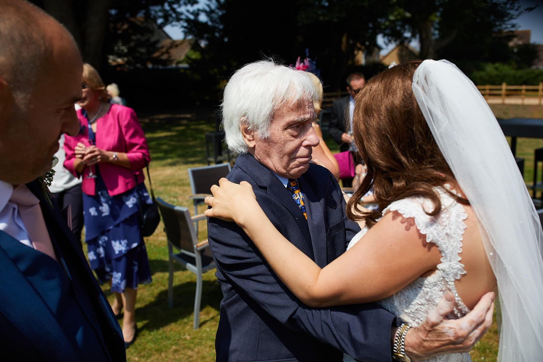 AS grandfather embraces his daughter with complete adoration on her wedding day.