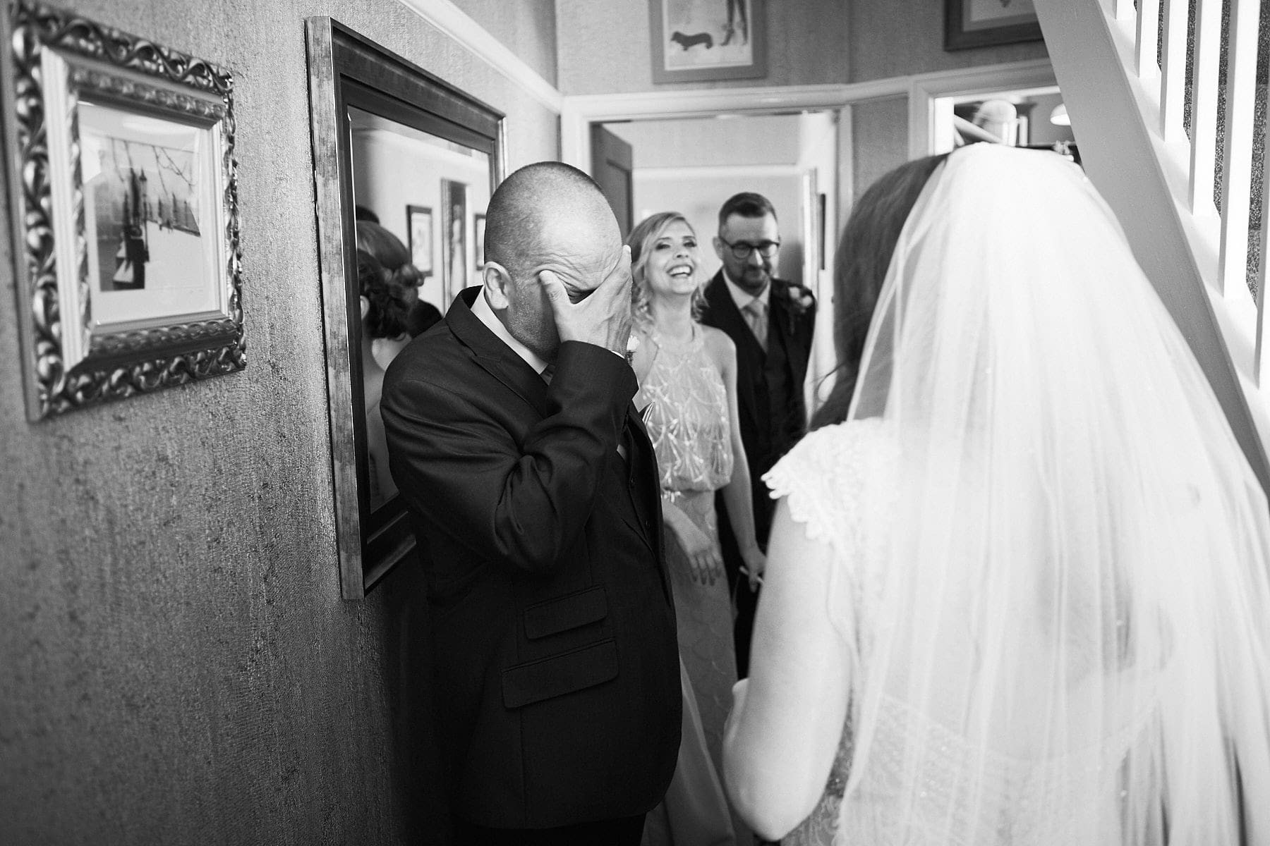 A father is overwhelmed seeing his daughter in her wedding dress for the first time.