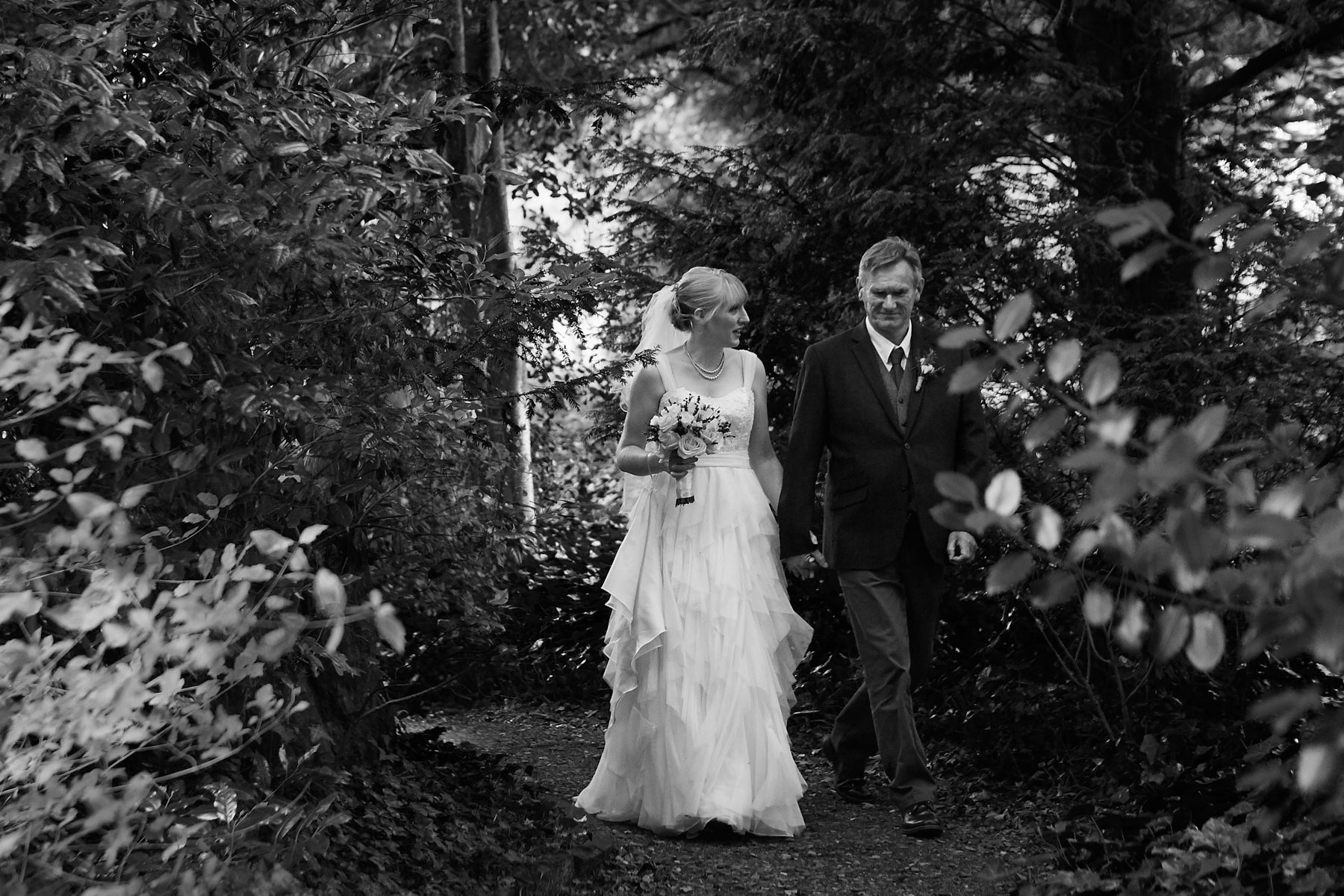 A father walks his daughter to the church at National Trust Wedding Venu Gunby Hall
