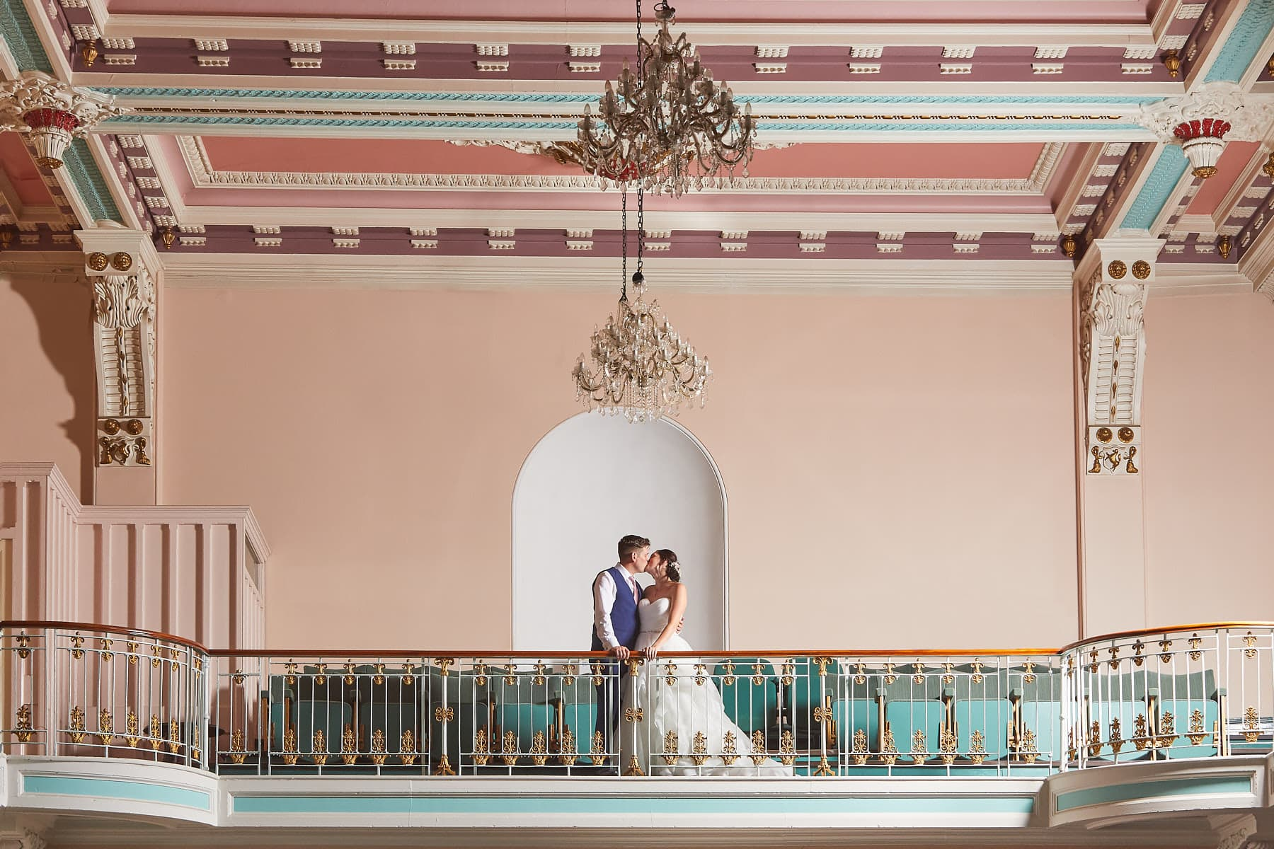 A couple spend time at Louth Town Hall balcony on their wedding day